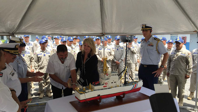 Luis Gustavo Mata Vega, Costa Rican minister of public security (center) cuts a cake shaped like a 110-foot patrol boat Oct. 13, 2017, to celebrate the transfer of two of the ships to Costa Rica. The four officials surrounding him are, from left: Col. Martin Arias Araya, director of the Costa Rican coast guard; Vice Adm. Sandra L. Stosz, U.S. Coast Guard deputy commandant for mission support; Ambassador Sharon Day, chief of mission for the U.S. embassy in Costa Rica; and Cmdr. Brent Bergan, U.S. senior defense official and defense attaché to Costa Rica. U.S. Coast Guard photo.
