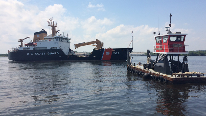 Coast Guard Cutter Willow sails away from the Coast Guard Yard in Curtis Bay, Maryland.
