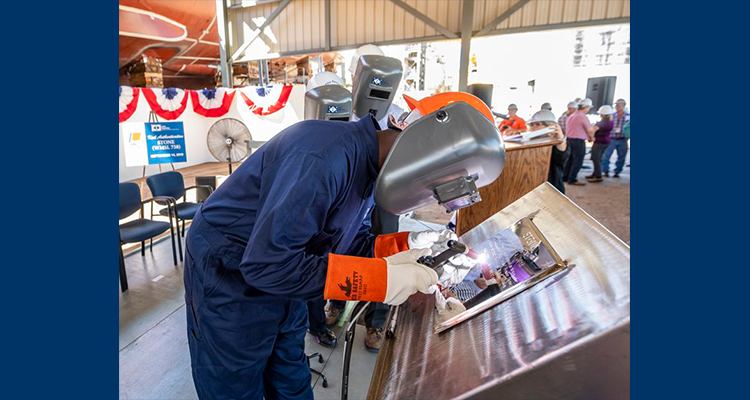 Laura Cavallo are welded onto a steel plate that will later be affixed to Coast Guard Cutter Stone