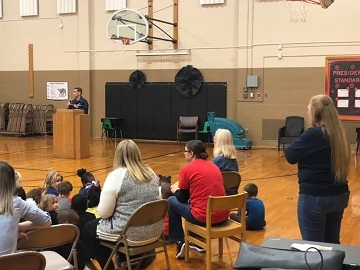 CWO Morgan Ferrer addresses students at a veterans day event assembly at Lowman Hill elementary Topeka on 14 Nov 2019