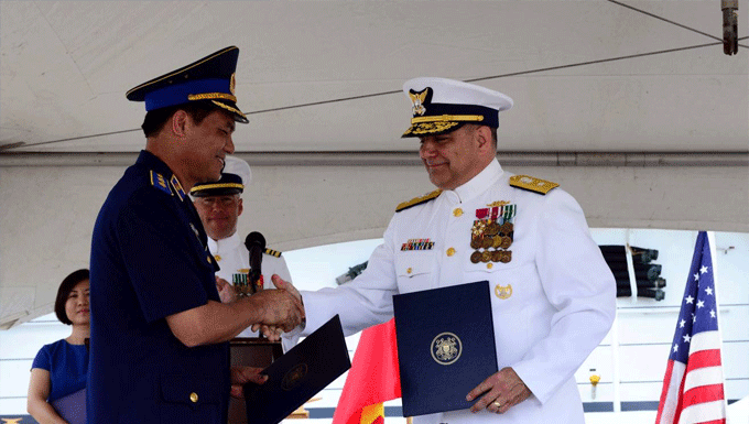 Lt. Gen. Nguyen Quang Dam, commandant of the Vietnamese coast guard, and Rear Adm. Michael J. Haycock