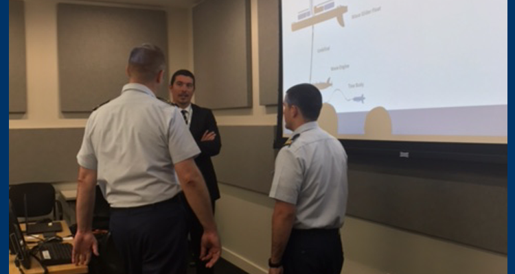 Two Coastguardsmen discuss unmanned surface vehicle capabilities with an industry representative during a technology demonstration hosted by the Innovation Council at Coast Guard headquarters in Washington, D.C., Oct. 19, 2017.